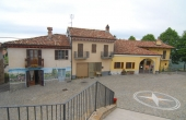 RDN010, Overlooking the main square of Roddino, a large village house in need of restoration